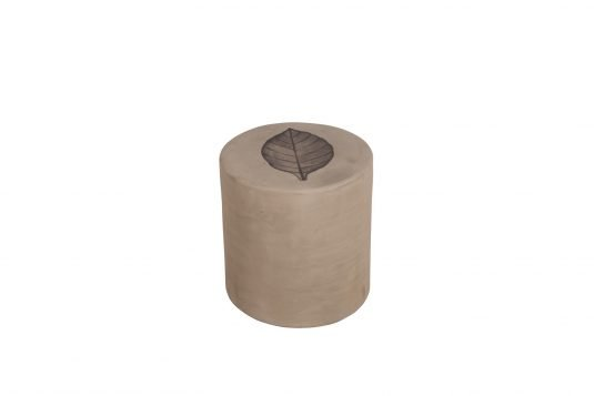 Picture of round cement stool with decoration from front